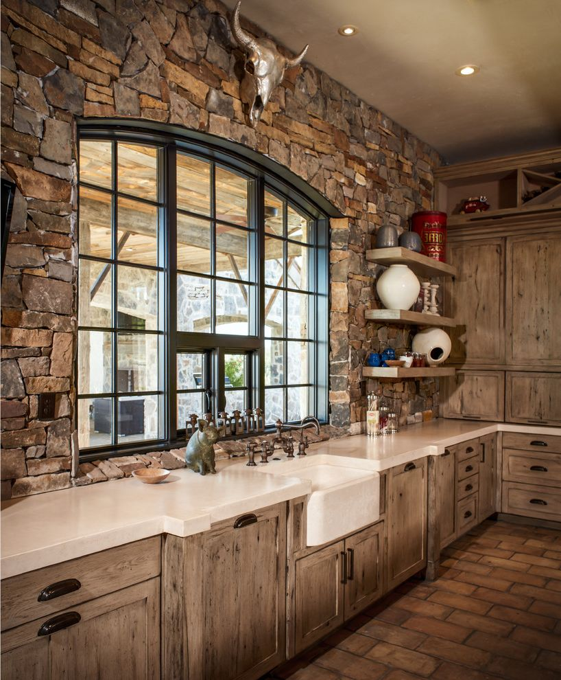 Thompson Creek Windows with Rustic Kitchen  and Apron Front Sink Apron Sink Arched Windows Bin Pulls Black Windows Cup Drawer Pulls Distressed Wood Farm Sink Floating Shelves Spanish Tile Floor Stone Wall White Counters