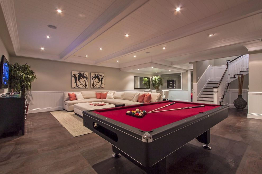 Thrasher Basement with Contemporary Basement  and Artwork Box Beams Pillows Pool Table Recessed Lights Red Sectional Sofa Staircase Tongue and Groove Ceiling Waincotting Wood Ceiling Wood Floor