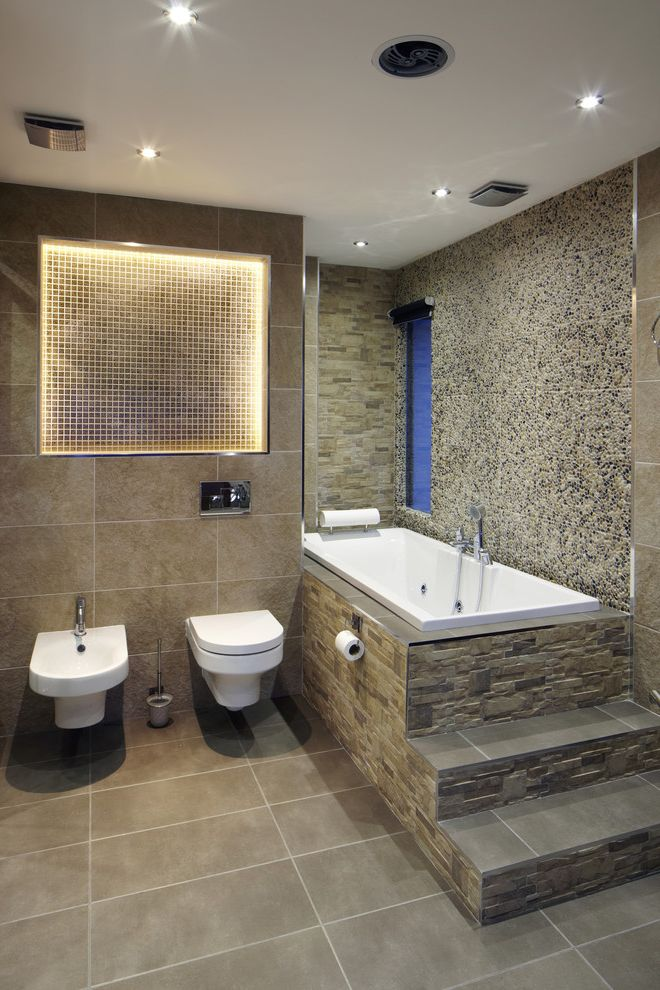 Toilet Bidet Combo   Contemporary Bathroom Also Aggregate Cove Lighting Mosaic Tile Alcove Neutral Recessed Lights Slit Window Soaking Tub Stone Facade Stone Walls Tall Narrow Window Tile Floor Tile Tub Deck Tile Walls Wall Mount Toilet and Bidet