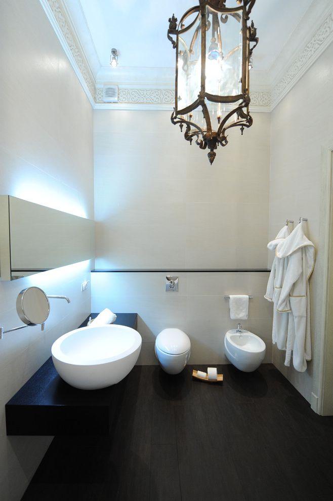 Toilet Bidet Combo with Contemporary Bathroom Also Backlighting Bathroom Mirror Bidet Cosmetics Mirror Crown Molding Dark Floor Floating Vanity Lantern Minimal Pendant Lighting Vessel Sink Wall Mount Faucet White Wood Wood Trim