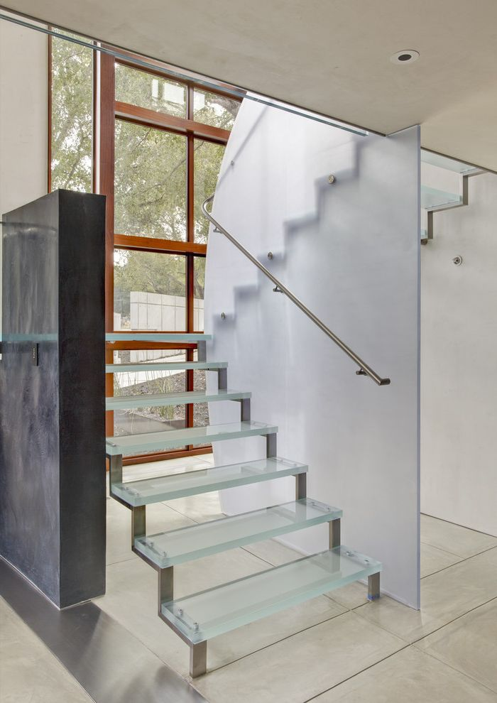 Unique Champagne Glasses with Contemporary Staircase  and Concrete Freestanding Staircase Guardrail Neutral Colors Open Risers Translucent