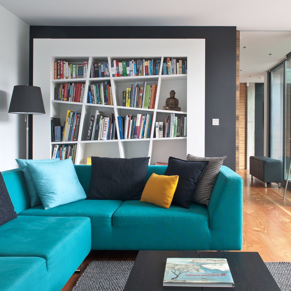 Unusual Bookcases with Contemporary Living Room  and Black Coffee Table Blue Sofa Book Shelf Book Storage Colourful Decor Contemporary Living Room Corner Sofa Floor Lamp Turquoise White Shelf Yellow Cushion