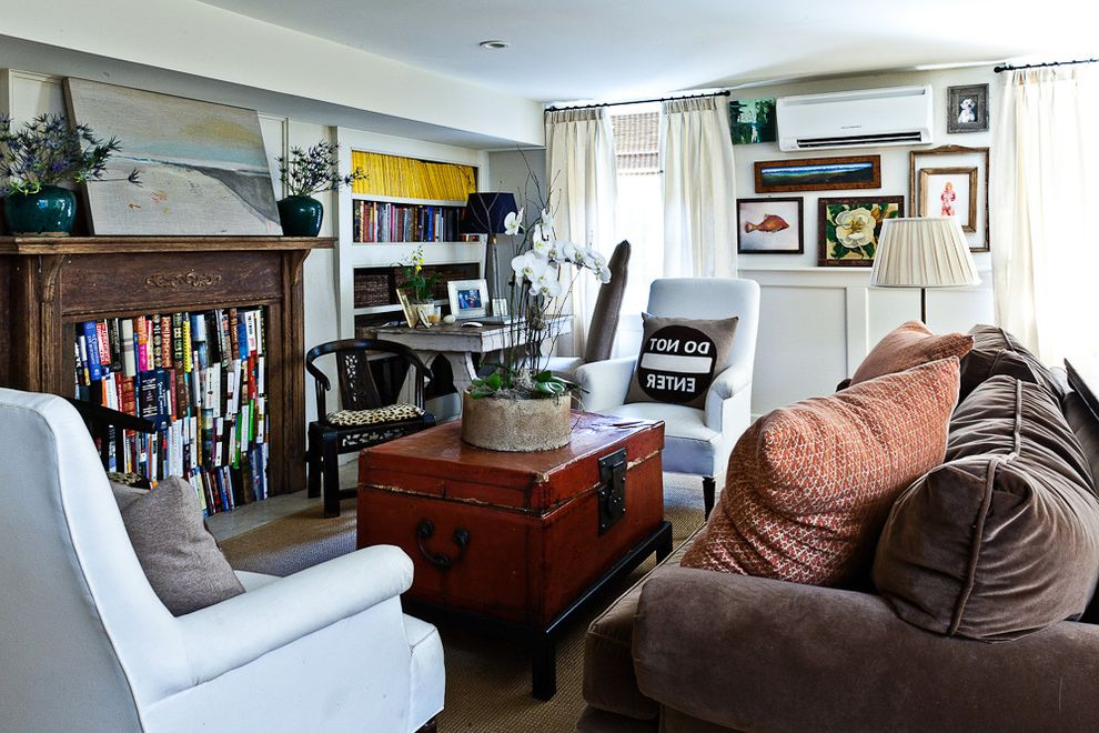 Unusual Bookcases with Eclectic Living Room Also Alternative Use for a Fireplace Brown Couch Built in Bookshelf Low Ceilings Repurposed Fireplace Unusual Bookcase
