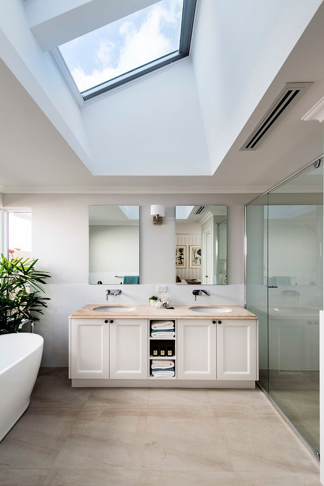 Velux Skylight Sizes with Traditional Bathroom  and Classic Design Double Vanity Hamptons Style Open Towel Storage Skylight Slanted Ceiling Two Mirrors Two Sinks Vaulted Ceiling Wall Mounted Faucet