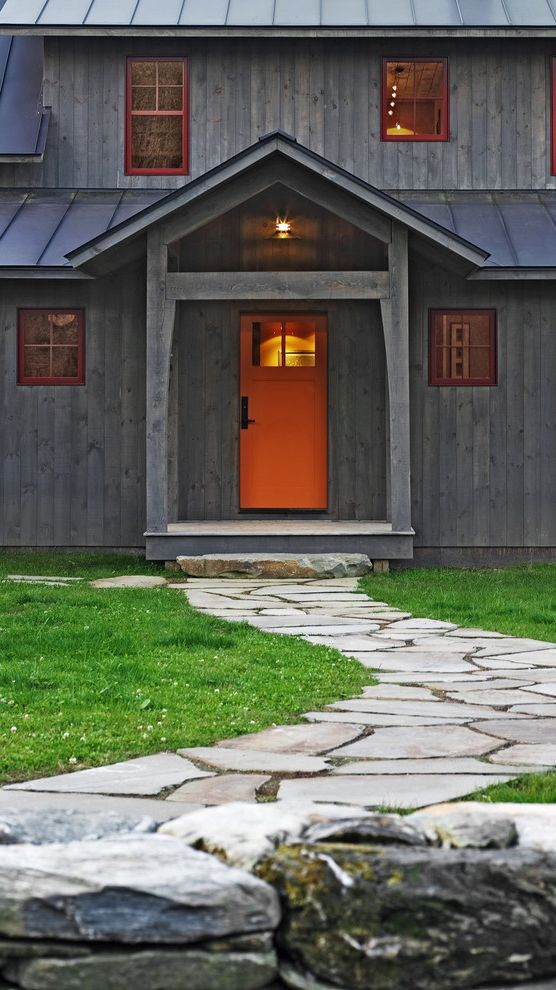 Versa Lok Colors   Rustic Exterior  and Covered Entry Farm Flagstone Path Lawn Metal Roof Orange Entry Door Painted Window Trim Rock Wall Rustic Stacked Stone Standing Seam Roof Vertical Wood Siding Weathered Wood