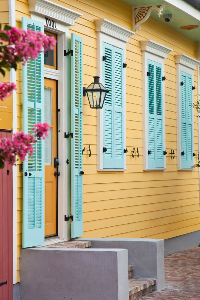 Versa Lok Colors with Contemporary Entry Also Black Hardware Brick Bright Colors Concrete Light Blue Shutters Sconce Steps White Trim Yellow Door Yellow Siding