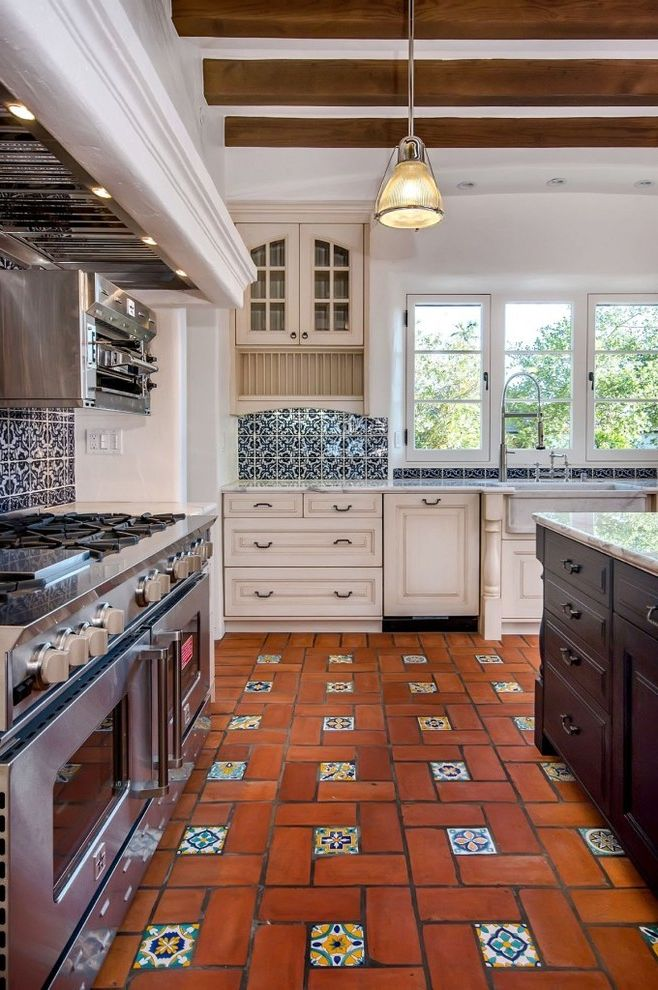 Vietri Dishes   Mediterranean Kitchen Also Apron Sink Casement Windows Glass Front Cabinets Kitchen Island Large Hood Pendant Light Plate Rack Professional Stove Recessed Lighting Stucco Walls Terra Cotta Floor Tile Backsplash Tile Inlay White Walls