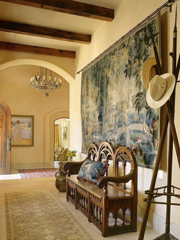 Ways to Hang Tapestry   Mediterranean Hall  and Archway Coat Rack Decorative Wall Tapestry Entry Bench Exposed Beams Hat Stand High Ceilings Ornate Bench Rug Runner Tile Floor