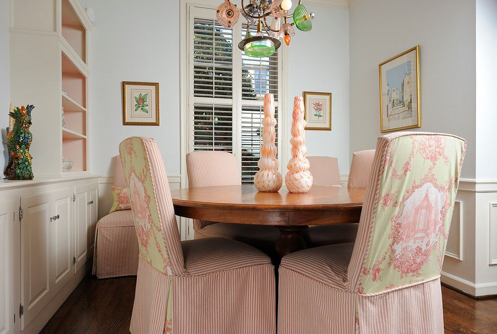 What is a Parsons Chair with Eclectic Dining Room Also Artwork Built in Cabinets Chair Rail Dining Table Framed Art Modern Chandelier Open Shelves Pink Shutters Slipcover Ticking Toile Wall Art White Walls Wood Floor