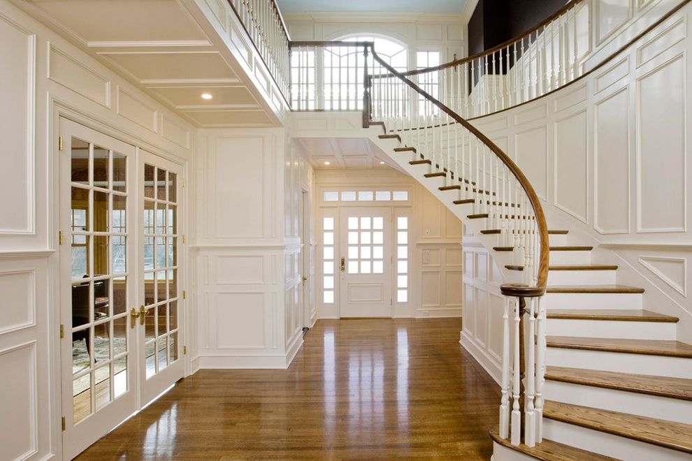 What is Quarter Sawn Oak   Traditional Entry  and Custom Carpentry Custom Woodworking Frame and Panel French Doors Interior Design Interior Woodworking Oak Paneling Sweeping Staircase White Wood Floor Wood Handrail