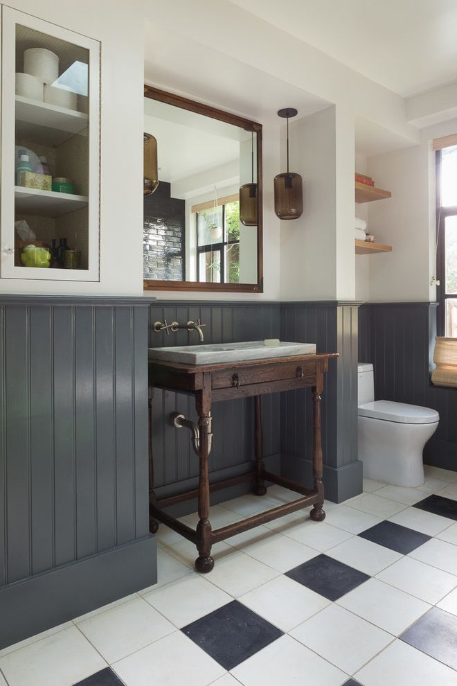 What is Wainscoting with Eclectic Bathroom Also Antiques Black and White Floor Tile Framed Mirror Gray Wainscoting Pendant Light Wall Mounted Faucet