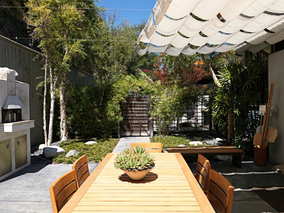 Wind Sail Shade with Asian Patio Also Asian Bench Fenced Yard Gate Ground Cover Japanese Door Outdoor Dining Furniture Outdoor Oven Partially Covered Patio Potted Succulents Sun Awning Sun Shade Trees Wood Gate