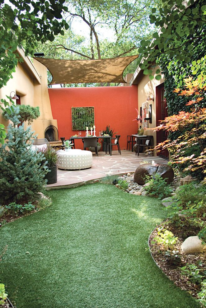 Wind Sail Shade with Mediterranean Landscape Also Denver Interior Designer Emu Furniture Japanese Maple Living Wall Outdoor Fireplace Red Privacy Wall Santa Fe Courtyards Santa Fe Interior Designers Stone Patio Succulent Wall Sun Shade