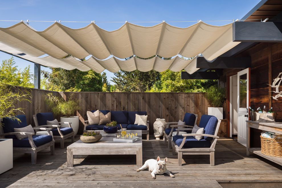 Wind Sail Shade with Midcentury Deck  and Fence Outdoor Furniture Outdoor Living Outdoor Pillows Outdoor Seating Outdoor Table