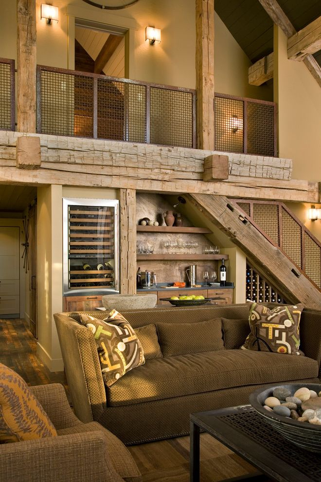 Wine Fridge Lowes with Rustic Living Room  and Brown Sofa Contemporary Living Room Exposed Rafters Loft Mountain Contemporary Open Shelves Patterned Pillows Rafter Tails Ranch Home Renovation Stairs Stemware Wine Bar Wine Cabinet Wine Fridge Wood Posts