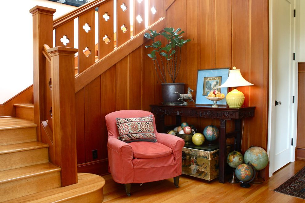 World Globes for Sale with Traditional Entry  and Console Cutout Globe Globes Red Chair Stair Rail Wood Paneling Wooden Staircase