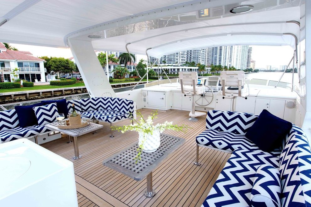 Yacht Bedding   Beach Style Deck  and Blue Chevron Cushions Boat Built in Furniture Chevron Cushions Chevron Pattern Chevron Sofa Curved Sofa Floral Arrangement Navy Pillows Pedestal Coffee Table Ship Wood Coffee Table Wood Deck Yacht