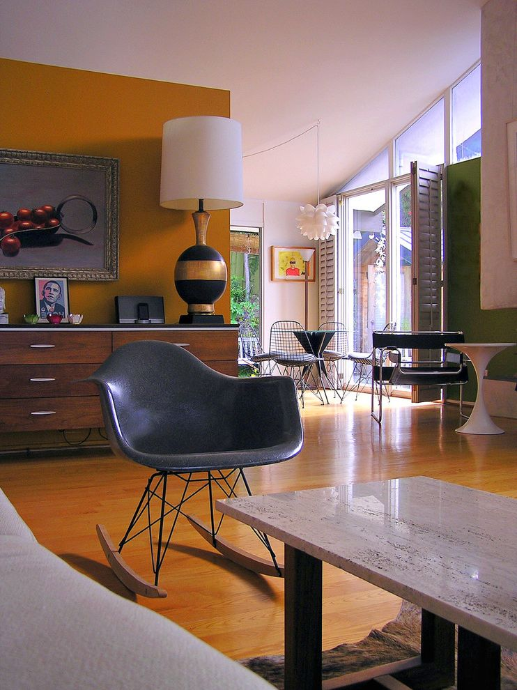 Accent Chairs on Sale   Midcentury Living Room  and Accent Wall Mid Century Modern Modern Icon Modern Rocking Chair Open Floor Plan Orange Walls Ranch Retro Sloped Ceiling Stone Coffee Table Vaulted Ceiling Wood Flooring