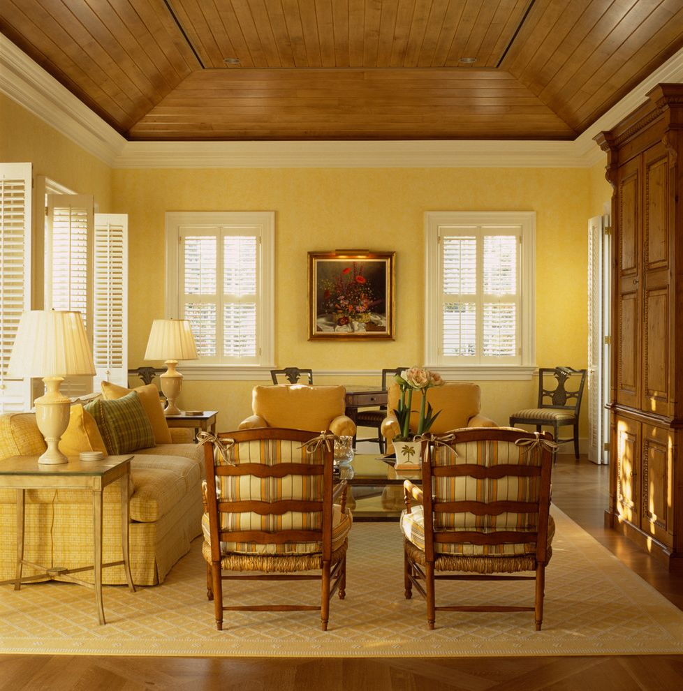 Ashley Furniture Reno   Traditional Family Room  and Chair Rail Decorative Paint Ladder Back Chairs Parquet Wood Floor Plantation Shutters Stark Carpet Vaulted Ceiling Wood Plank Tray Ceiling Wood Shutters