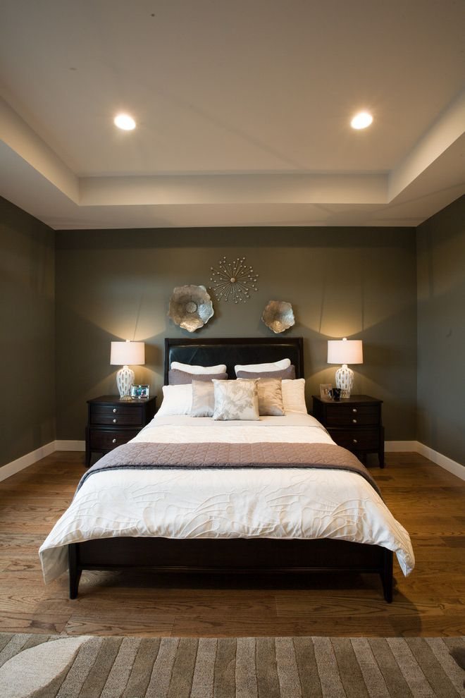 Ashley Furniture Reno   Transitional Bedroom Also Baseboards Bed Pillows Bedside Table Ceiling Lighting Decorative Pillows Gray Walls Nightstand Recessed Lighting Throw Pillows Tray Ceiling Upholstered Headboard Wall Art White Bedding Wood Flooring