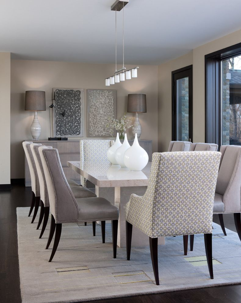 Ashley Furniture Reno with Contemporary Dining Room  and Area Rug Artwork Baseboards Dark Floor Dark Trim Linear Chandelier Nailhead Trim Neutral Tones Sideboard Tan Walls Upholstered Dining Chairs
