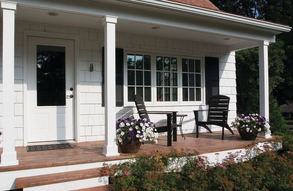 Ashley Furniture St Louis with Traditional Porch  and Black Shutters Cottage Door French Windows Garden Chair Garden Furniture Painted Shingle Shingle Shutters White Wooden Posts