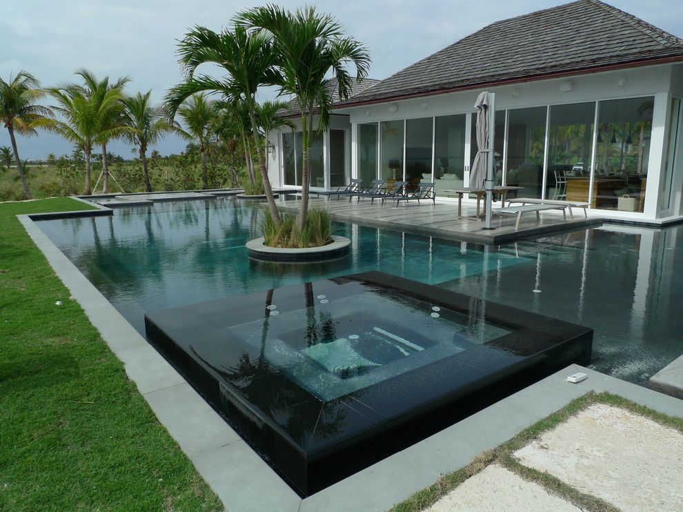 Bakers Bay Bahamas   Beach Style Pool  and Delray Beach Swimming Pools Landscape Architects Designers Palm Beach County Swimming Pool Builders Relaxed Layback Style Pool Swimming Pool Builders in Jupiter Tucker Design Build