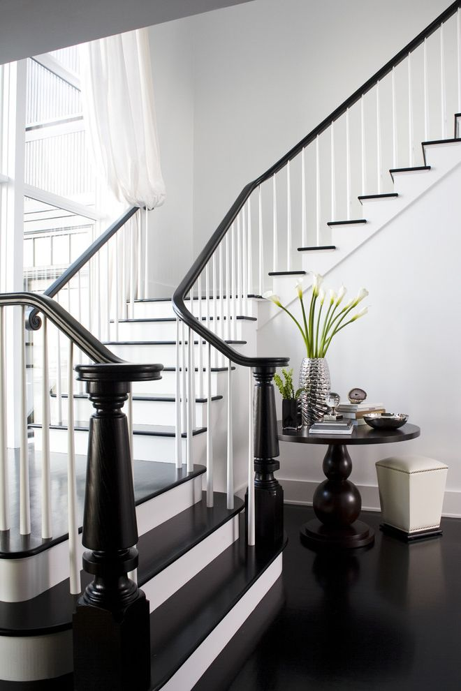 Baluster Spacing   Transitional Staircase  and Black and White Black Floor Dark Floor Dramatic Entrance Entry Entry Table Floral Arrangement Foyer Pedestal Table Tablescape Vignette White White Wood Wood Flooring Wood Trim Wooden Staircase