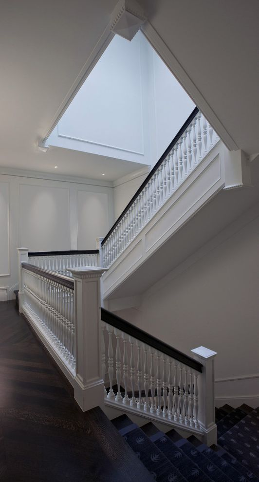 Baluster Spacing with Traditional Staircase Also Carpeted Stair Runner Chevron Floor Dark Stained Wood Floor Frame and Panel Walls Spindle Balusters White Painted Wood