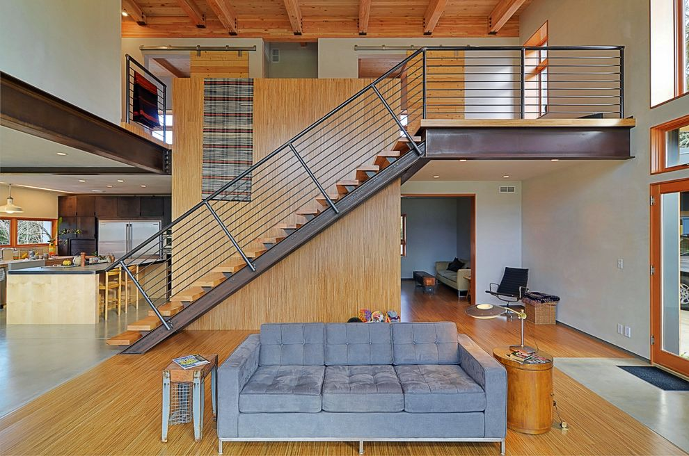 Barndoor Hardware   Contemporary Staircase  and Bamboo Concrete Floor Gray Tufted Upholstery Knotty Pine Living Area Open Floor Plan Open Tread Staircase Seating Steel Girder Vaulted Ceiling White Walls Wood Ceiling Wood Floor