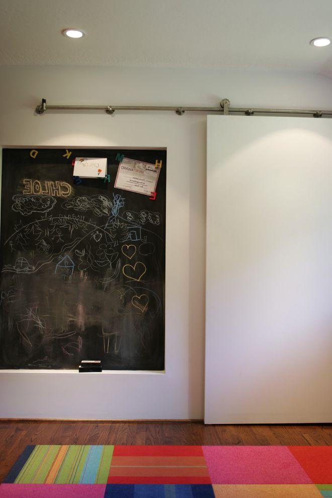 Barndoor Hardware with Contemporary Spaces Also Area Rug Barn Door Ceiling Lighting Chalkboard Wall Dark Floor Patchwork Rug Playroom Recessed Lighting Sliding Door Wood Flooring