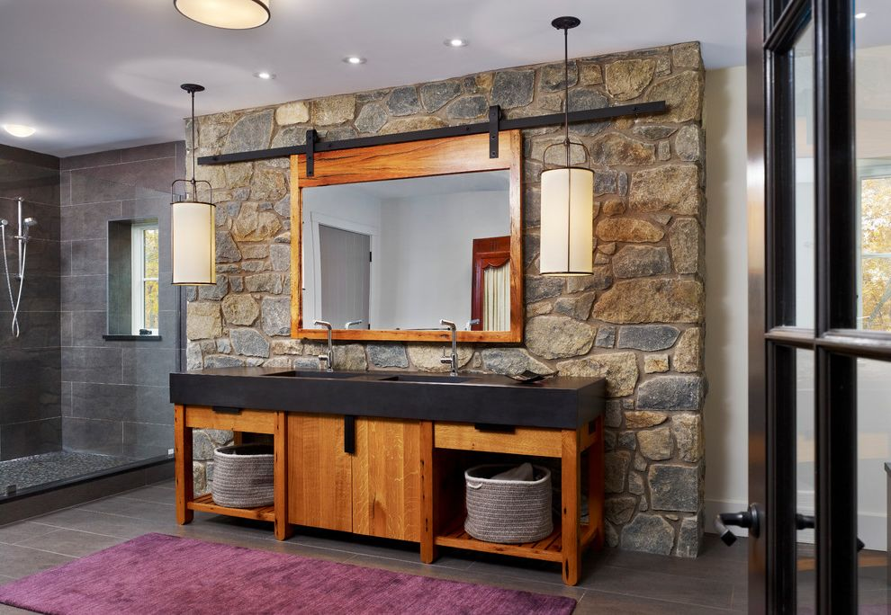 Barndoor Hardware with Farmhouse Bathroom  and Baskets Black Counter Clear Glass Shower Hanging Drum Pendant Lights Large Vanity Open Vanity Pebble Tile Purple Rug Stone Wall Tile
