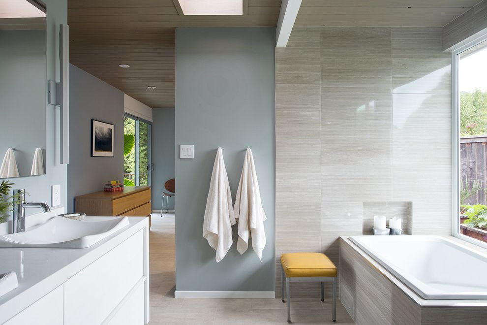 Blue Sky Pest Control   Contemporary Bathroom  and Candles Double Sinks Double Vanity Eichler Frameless Mirror Glossy Tiles Large Window Midcentury Modern House Natural Light Neutral Colors Renovation Sky Light Wood Ceiling Yellow Bench Seat