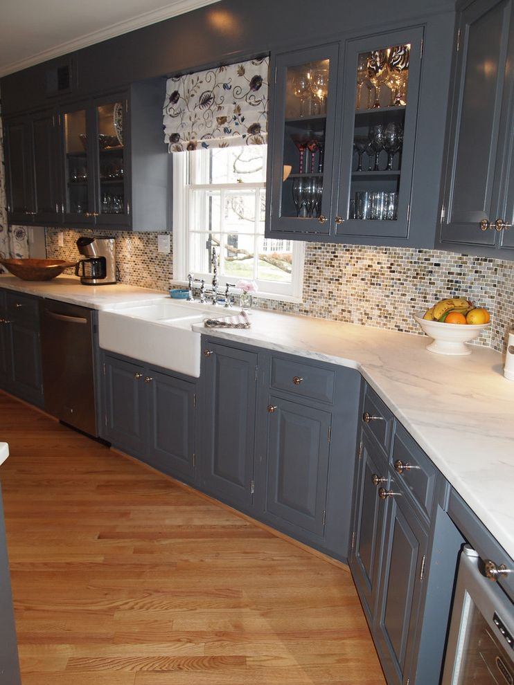 Blue Sky Pest Control   Traditional Kitchen Also Blue Kitchen Cabinets Farm Style Sink Farmhouse Sink Marble Counters Mosaic Backsplash Navy Blue Cabinets Wood Island Top