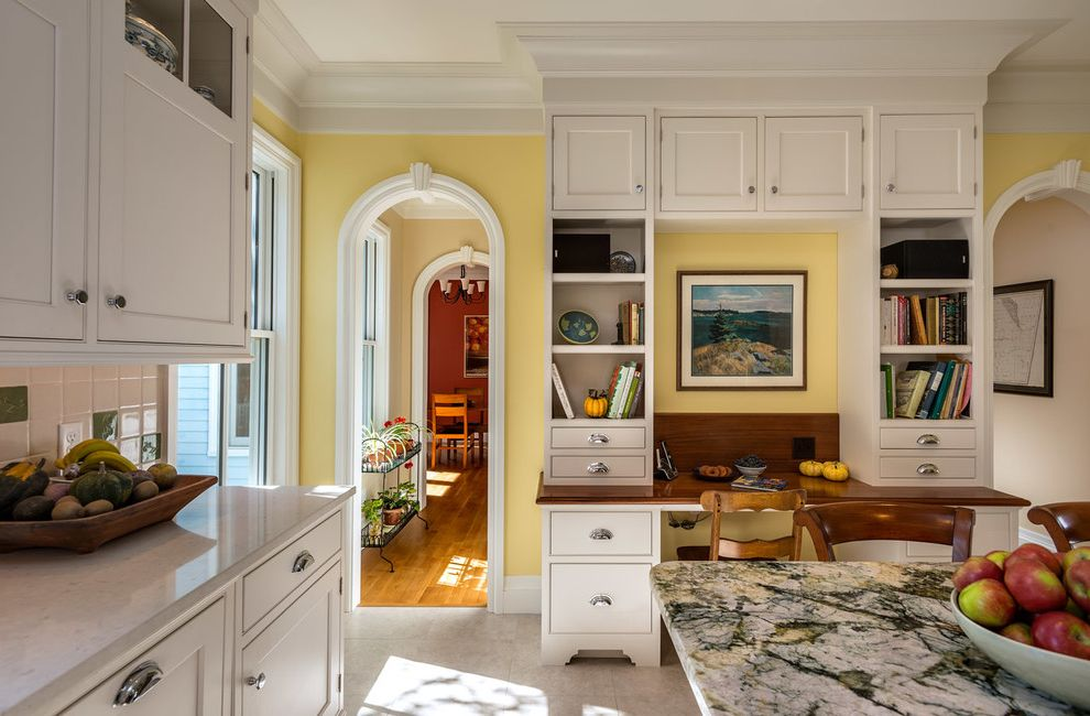 Boston Granite Exchange with Traditional Kitchen  and Arched Doorway Built in Desk Crown Molding Dark Wood Bar Stools Dark Wood Counter Stools Framed Artwork Home Office Kitchen Island White Kitchen Yellow Wall