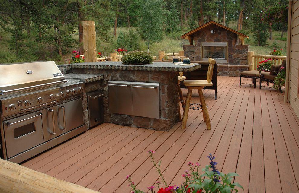 Brookside Lumber   Rustic Deck  and Outdoor Bar Outdoor Fireplaces Outdoor Kitchen Rustic Deck Stone