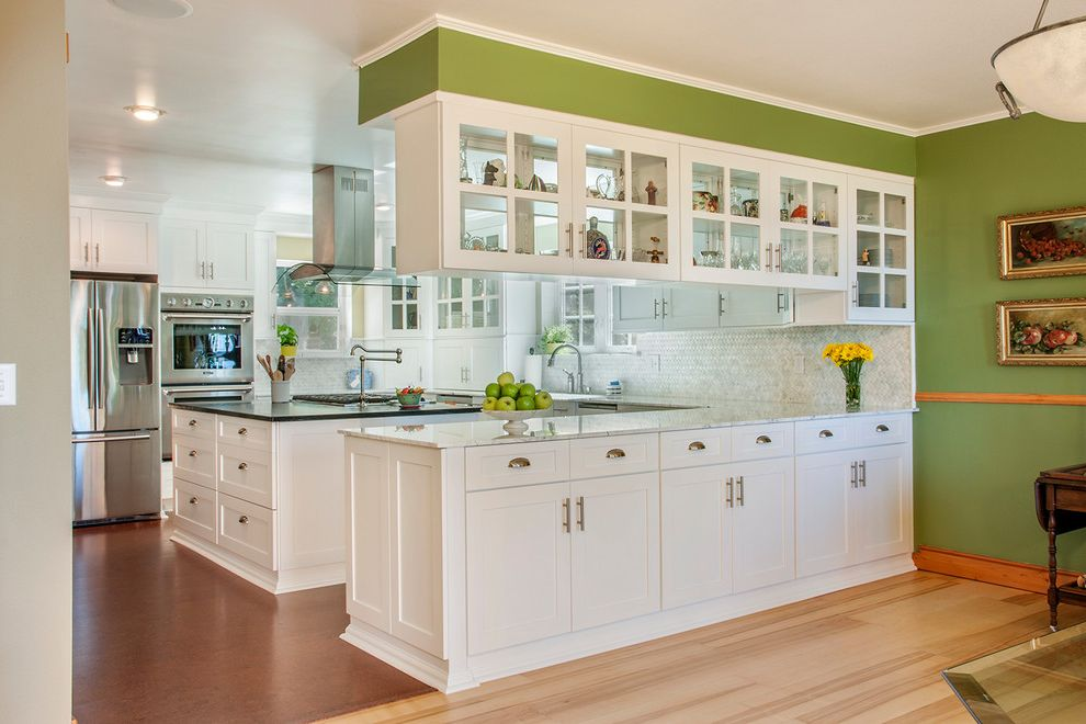 Canyon Creek Cabinets   Traditional Kitchen Also Black Countertop Ceiling Light Cup Pulls Framed Art Glass Panel Cabinets Green Wall Island Storage Light Hardwood Flooring Neutral Colors Polished Floor Pot Filler Vent White Island Window