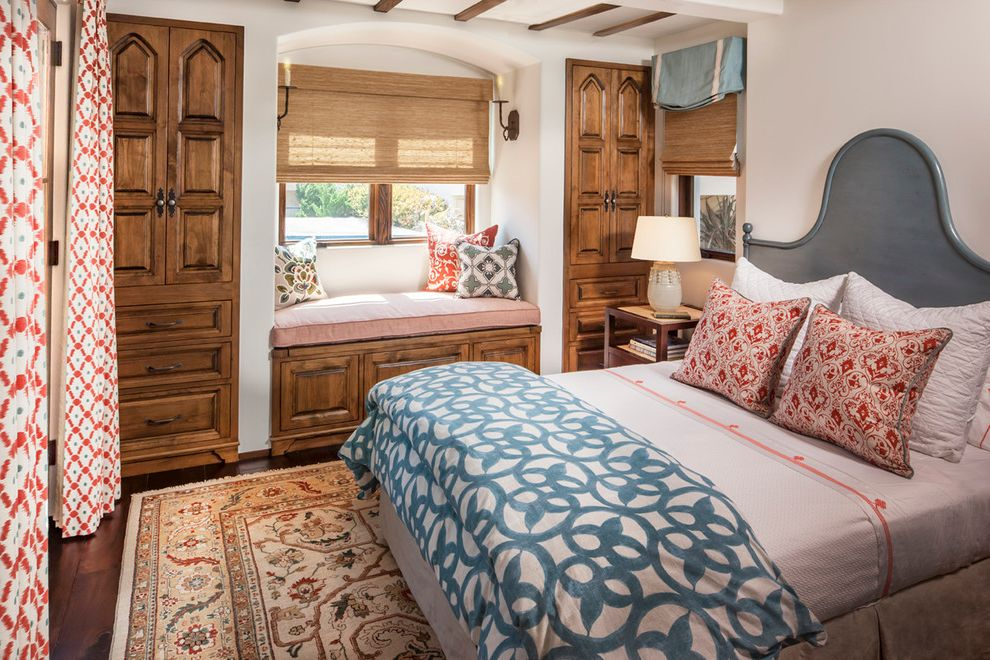 Closet in Spanish   Mediterranean Bedroom Also Bamboo Shade Blue and White Blue Headboard Coral and White Dark Stained Wood Window Seat