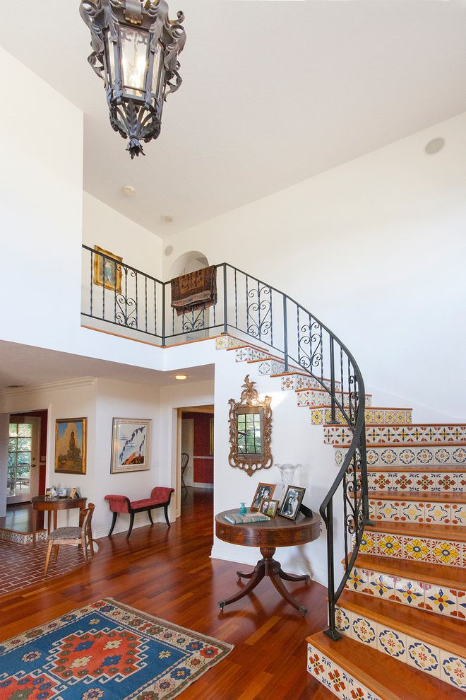 Closet in Spanish   Mediterranean Staircase  and Coral Bench Entry Ornate Mirror Spanish Chandelier Spanish Tile Staircase Wood Floor