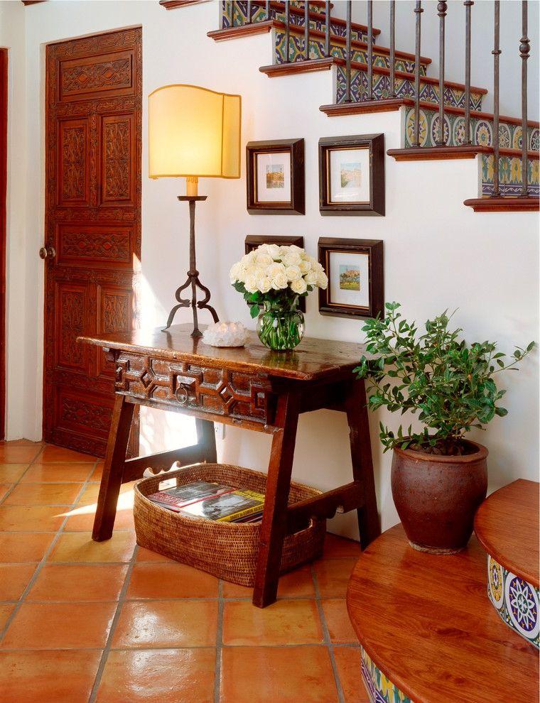 Closet in Spanish   Rustic Hall  and Carved Wood Door Floral Arrangement Houseplants Roses Rustic Spanish Tile Table Lamp Terracotta Tile Tile Floor White Flowers Wood Flooring Woven Basket