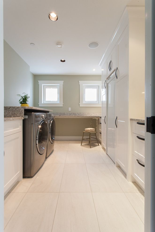 Closet in Spanish   Transitional Laundry Room  and Built in Cabinetry Chair Counter Dark Hardware Front Loading Washer Dryer Laundry Storage Light Green Wall Long Room Neutral Colors Recessed Lights Small Windows Square Windows Tile Floor White Cabinets