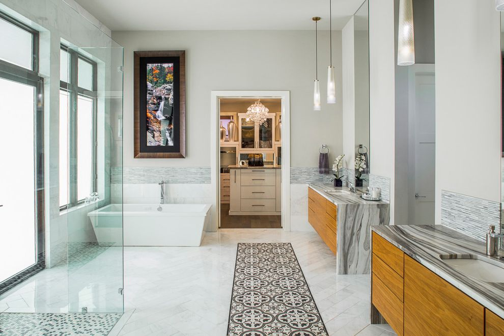 Closet in Spanish with Contemporary Bathroom  and Closet in Bathroom Custom Home Double Sinks Double Vanity Floating Vanity His and Hers Modern Freestanding Tub Modern Glass Entry Door Pendant Lights Spa Bathroom Transom Wall Art Waterfall Countertops