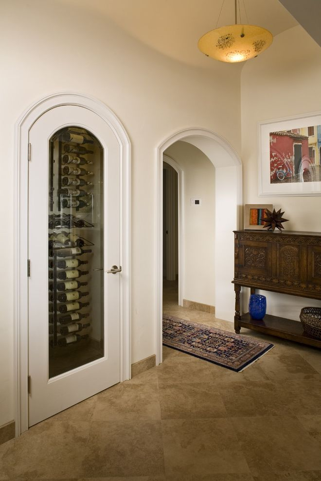 Closet in Spanish with Mediterranean Spaces Also Arch Door Arch Doorway Brown Glass Door Pendant Light Small Spaces Spanish Style Console Travertine Floor Tile White Wine Cellar Wine Storage