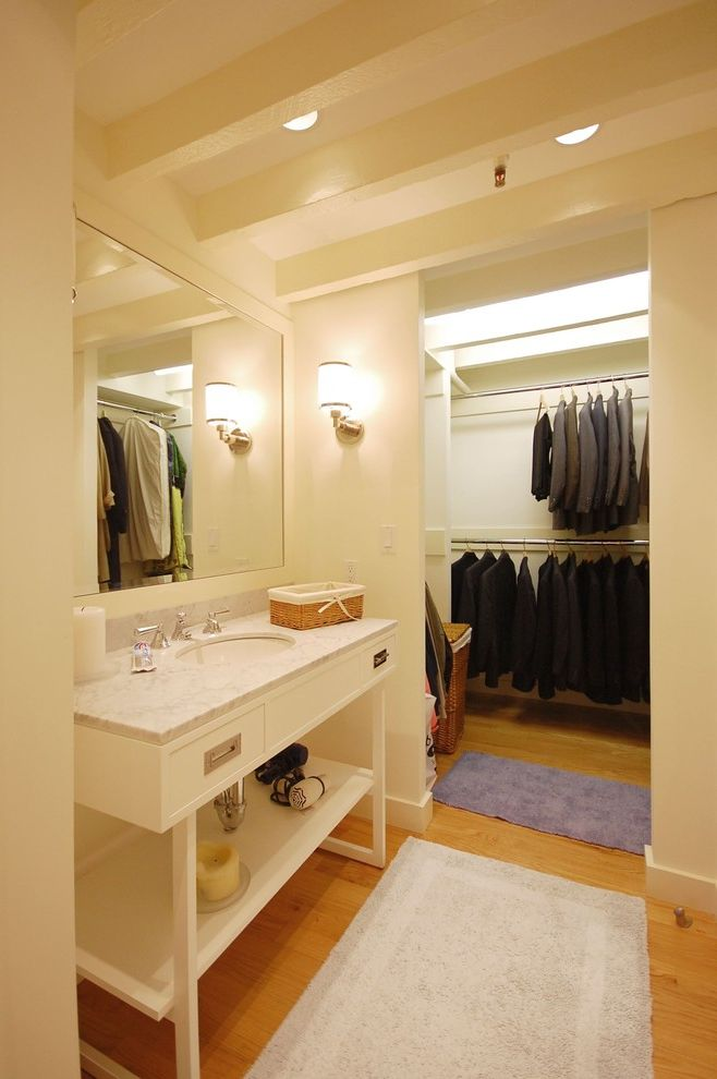 Closets to Go   Transitional Bathroom Also Bathroom Closet Double Hanging Rod Exposed Beams Marble Countertops Sconce Vanity Wall Lighting White Bathroom Wood Flooring