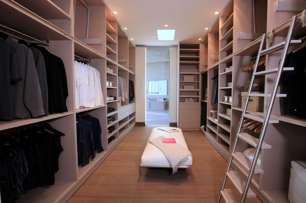 Closets to Go with Contemporary Closet Also Beige Ceiling Beige Wall Built in Closet Built in Clothing Rack Built in Shelves Custom Grey Ladder Library Ladder Modern Skylight White Bench Wood Floor