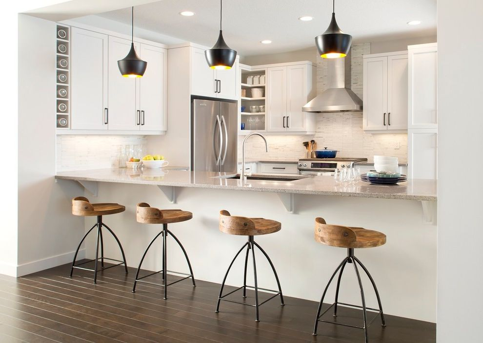 Costco Bar Stools   Contemporary Kitchen  and Black Beat Pendant Lights Blue Stockpot Frame and Panel Cabinets Hood Light Gray Metal and Wood Swivel Counter Stools Stainless Steel Tile Backsplash White Walls Wine Storage Wood Floor