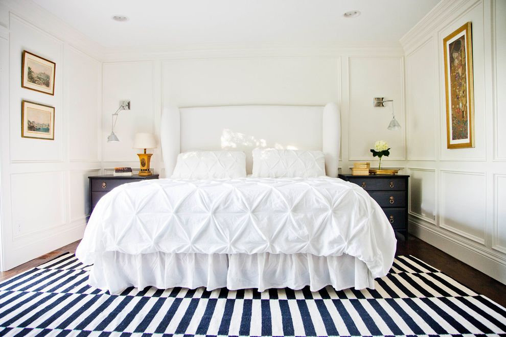 Difference Between Duvet and Comforter   Transitional Bedroom Also Art Black Nightstands Black Side Tables Brass Hardware Gold Frames Graphic Rug Paneling Striped Rug Upholstered Headboard Wainscot Wainscoting White Bedding White Headboard Wood Work