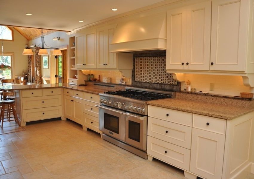 Dunmore Appliance    Kitchen  and Beige Kitchen Granite Countertops Open Concept Recessed Lighting Stainless Steel Appliances Tile Kitchen Wood Walls