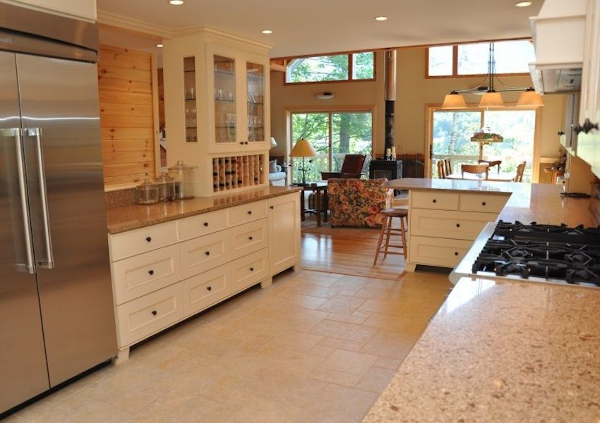 Dunmore Appliance with  Kitchen  and Beige Kitchen Granite Countertops Open Concept Recessed Lighting Stainless Steel Appliances Tile Kitchen Wood Walls