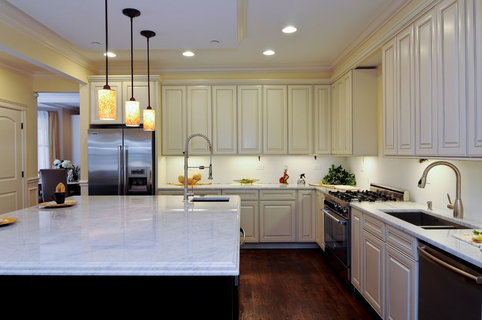 Dunmore Appliance with Traditional Kitchen Also Dark Wood Floor Faucet Kitchen Island Kitchen Island with Sink Large Kitchen Island Pendant Light Stone Countertop White Cabinets Wood Floor